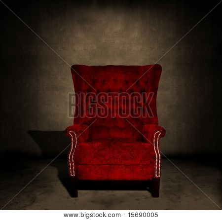 A grungy red velvet chair in a dark room