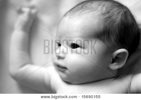 Black and white photo of a newborn baby