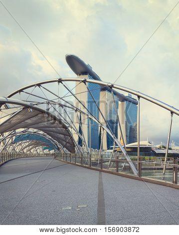 Singapore, Republic of Singapore - May 7, 2016: Helix spiral double bridge leading to Marina Bay Sands hotel