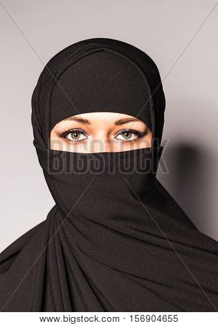 Young arabian woman in hijab or niqab
