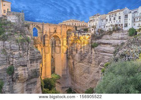 Illuminated Puente Nuevo bridge in the evening Ronda Andalusia Spain