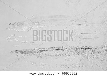 Closeup pale color and peeling of painted yellow cement wall textured background damaged by car in black and white tone