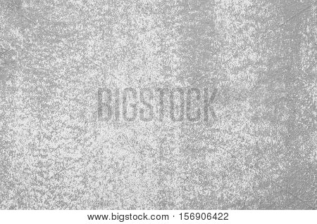 Closeup pale color and peeling of painted cement wall textured background in black and white tone