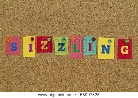 Sizzling word written on colorful sticky notes pinned on cork board.