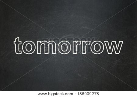 Time concept: text Tomorrow on Black chalkboard background