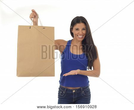 young happy and beautiful hispanic woman holding brown american shopping bag smiling excited isolated on white background in shopaholic fashion sales and consumerism concept