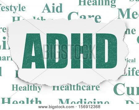 Medicine concept: Painted green text ADHD on Torn Paper background with  Tag Cloud