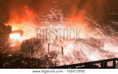 Sparks during opening of the blast furnace