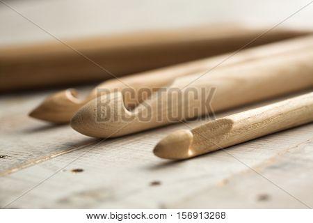 wooden knitting needles on wooden background wooden knitting needles on background of wooden painted floor
