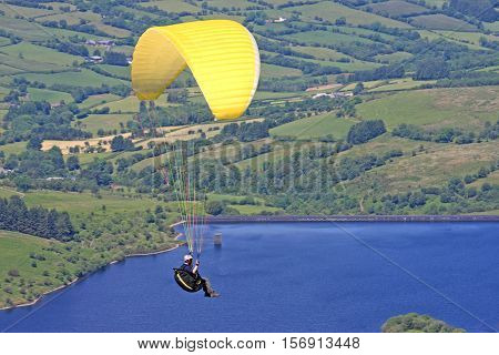 Paraglider flying above Cray reservoir in the Brecon Beacons
