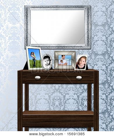 Interior of table, mirror and family photos against antique victorian wallpaper