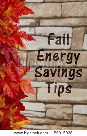 Energy savings tips message Some fall leaves on weathered bricks with text Fall Energy Savings Tips