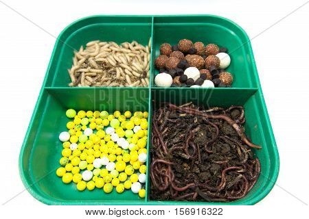 Baits for fishing. Group of earthworms. Mix baits for fishing.