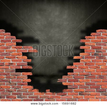Old crumbling brick wall in front of a grungy dark room