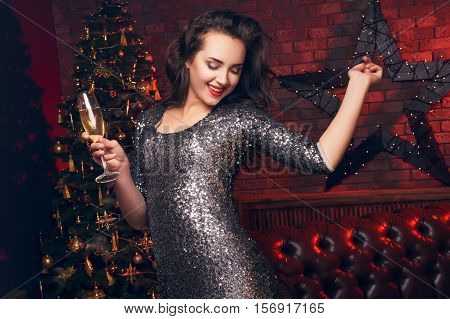 Beautiful Girl Happy To Christmas Night. Girl Dancing At The Club And Smile. Christmas Party. Clubbi