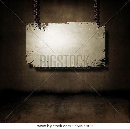 Metal banner hanging in a dark grungy room