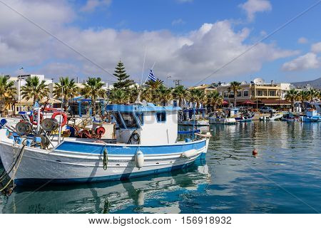 The scenic port with traditional fishing boats in the village of Kardamena, Kos island, Dodecanese, Greece.