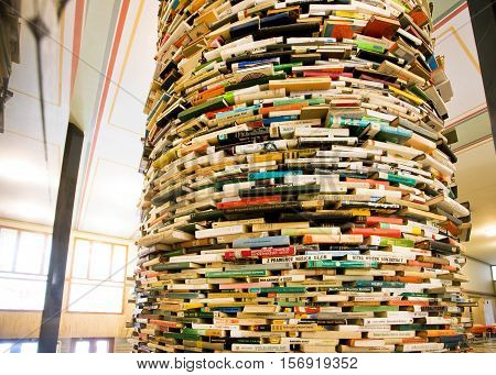 PRAGUE - MAY 14, 2014: Giant book shelf in the hall of Municipal Library of Prague on May 14 in Czech Republic. Prague's Library comprised of 42 branches 2 mobile libraries and 344000 books.