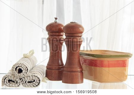 pepper mill, salt and other kitchen accessories whit white background