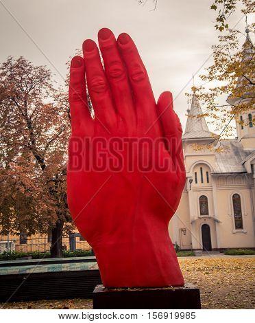 statue of a red hand in baia mare romania