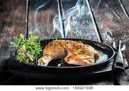 Piece Of Chicken With Fresh Marjoram Ready To Grill