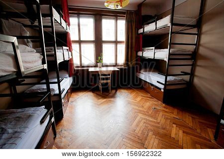 PRAGUE, CZECHIA - MAY 14, 2014: Clean bedroom without people inside a hostel for youth tourists on May 14, 2014. Prague receives more than 4.4 million international visitors annually
