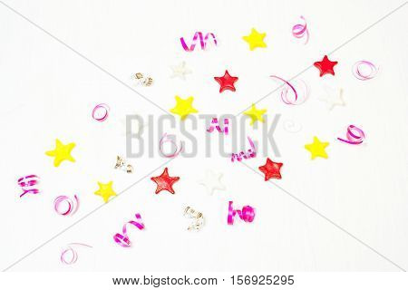 The décor of the stars confetti. The composition of the stars of the Christmas decor. Christmas New Year'sbirthday background