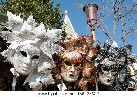 Venice, Italy - February 16, 2015: Group of traditional venetian carnival masks for sale during tne Carnival of Venice