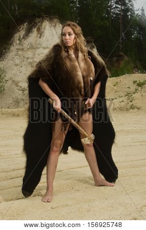 Prehistoric Woman With The Stone Axe Hunting