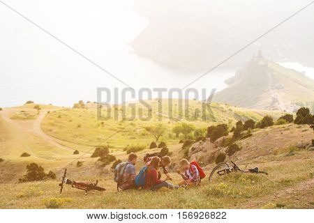happy family of four people eating fastfoodl in mountains. family concept