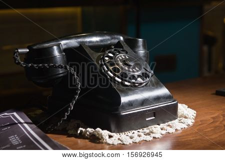 Old telephone Retrovintage telephone at pub interior