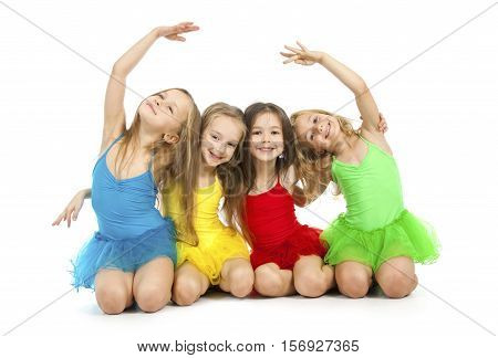Group of little beautiful ballet dancers isolated on white