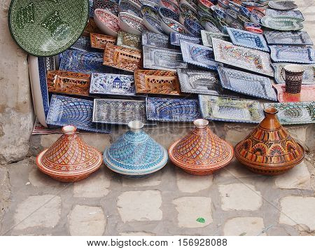 Ceramic souvenir ware with multi-colored national patterns