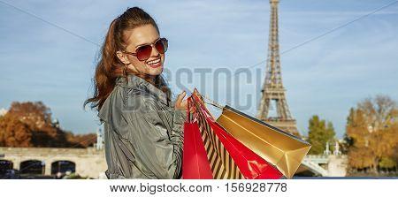 Happy Elegant Woman With Shopping Bags Near Eiffel Tower, Paris