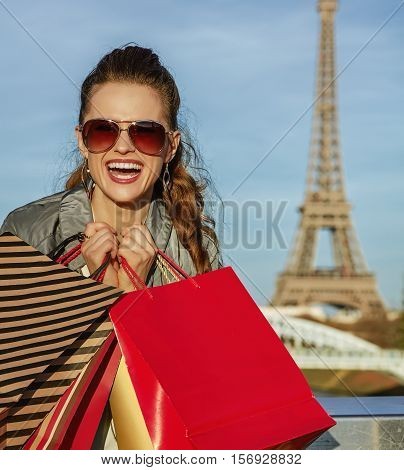Cheerful Elegant Woman With Shopping Bags Near Eiffel Tower