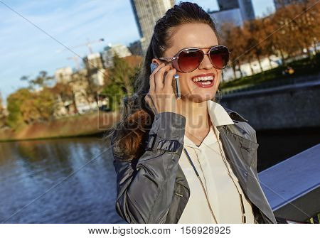 Smiling Fashion-monger Talking On Smartphone Near Eiffel Tower