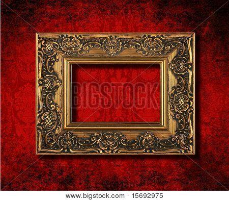 Antique gold frame on a grungy Victorian velvet wallpaper background