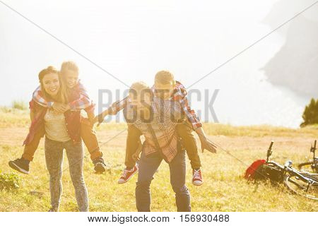 family concept. happy family of four people riding bikes at the mountain