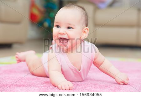 Smiling Sweet Baby Is Crawling On Carpet