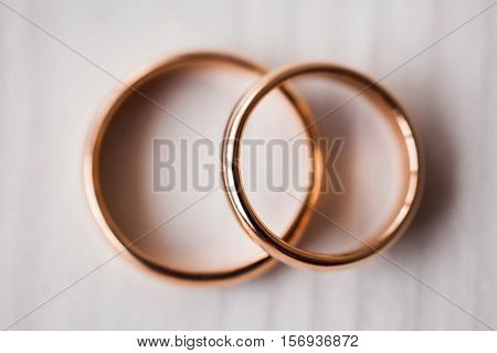 Wedding rings on a white background, wedding bands, infinity sign of the rings