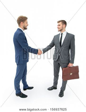 Two businessmen making agreement, their colleagues standing near
