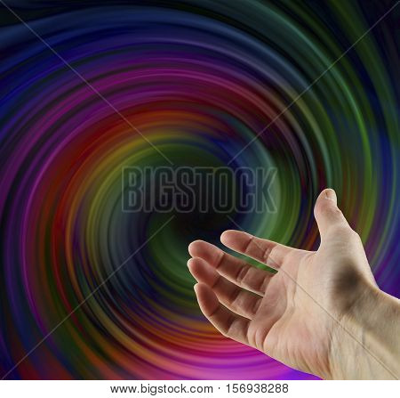 Metaphysical Vortex Activity - hand gesturing towards a dark multicolored spiraling vortex with a black centre