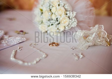 Wedding rings on a white background infinity sign of the rings wedding rings and jewelry bride