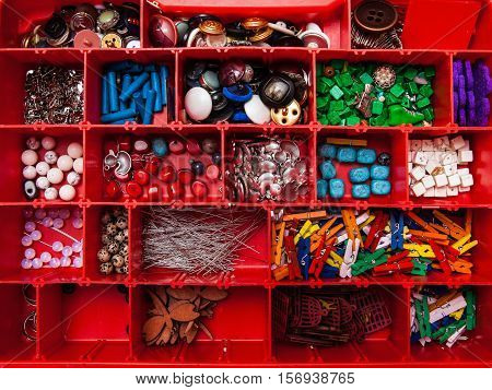 Crafts Jewelry Supplies in a red storage box