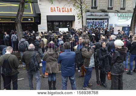 Paris,  France - November 13, 2016:  Crowd in front of the Bataclan paying tribute to the victims of the terrorist attacks