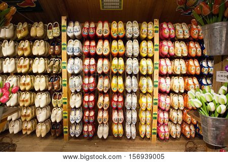 ZAANDAM, Holland - OCTOBER 24, 2016: Typical Dutch clogs for sale. Zaanse Schans is a museum village with dutch houses and wind mills.