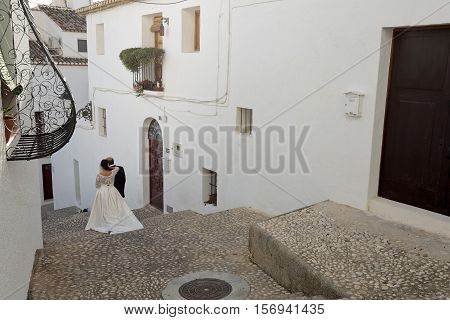 Altea, Spain. October 16, 2016: Newly married couple becoming photos in Altea, Alicante, Spain