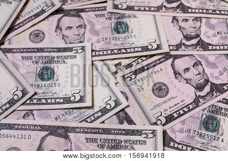 background of the money five dollar bills front side. background of dollars close up