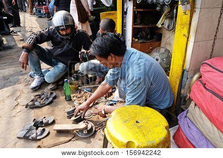 KOLKATA, INDIA - FEBRUARY 08: Streets of Kolkata, mechanic at workshop on Malik Bazaar, on February 08, 2016 in Kolkata, India