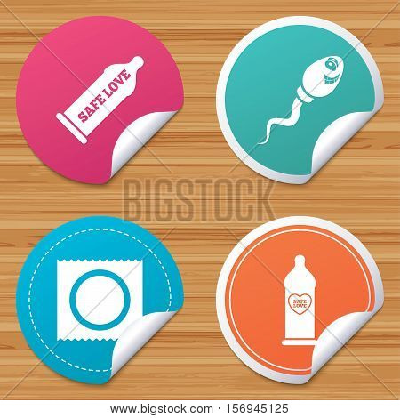 Round stickers or website banners. Safe sex love icons. Condom in package symbol. Sperm sign. Fertilization or insemination. Heart symbol. Circle badges with bended corner. Vector